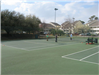 Group of People Playing Tennis