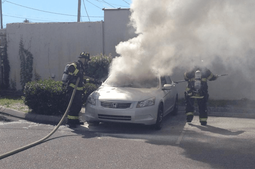 Firefighters Putting out a Fire in a Car
