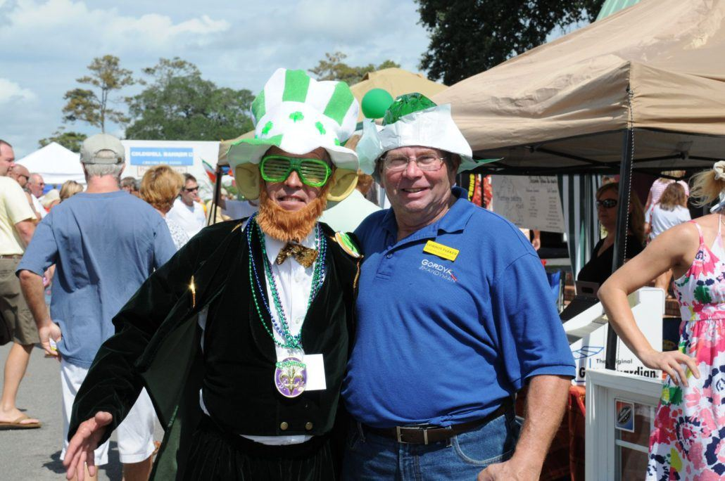 Two People Dressed in Irish Hats