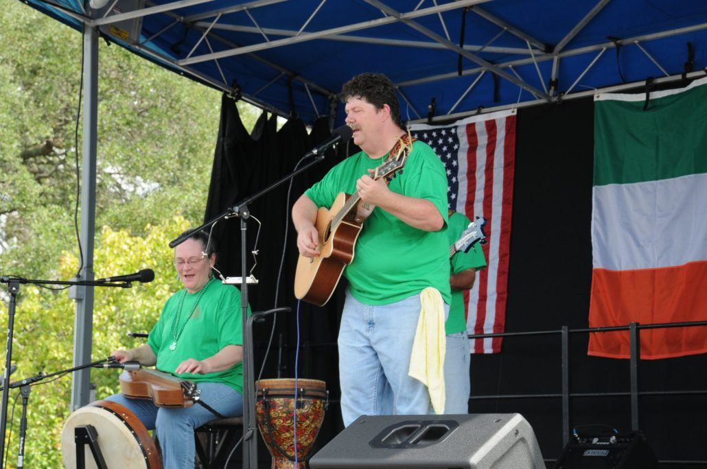 Two People Performing on Stage in Green