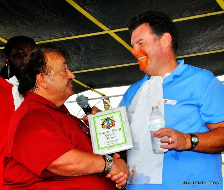Man Being Presented with the Spaghetti Eating Contest Award