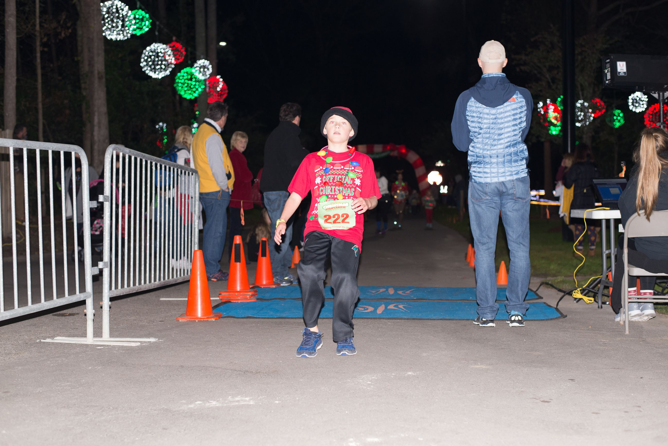Young Boy Standing Across the Finish Line