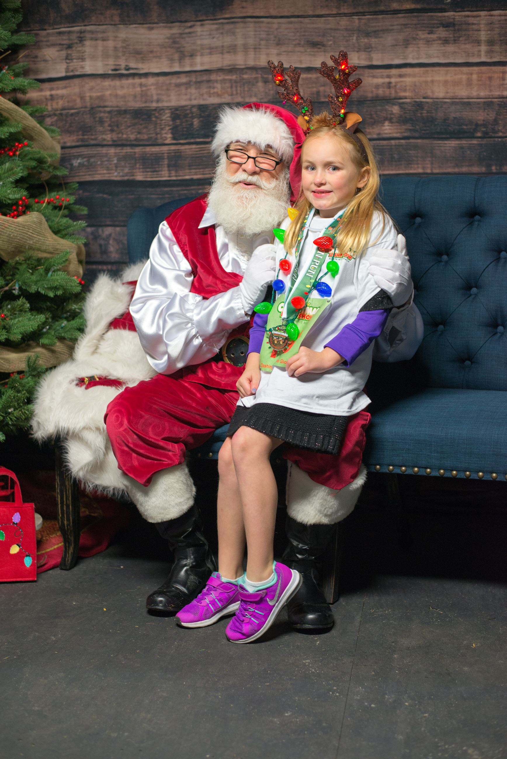 Young Girl Sitting on Santa Claus Lap