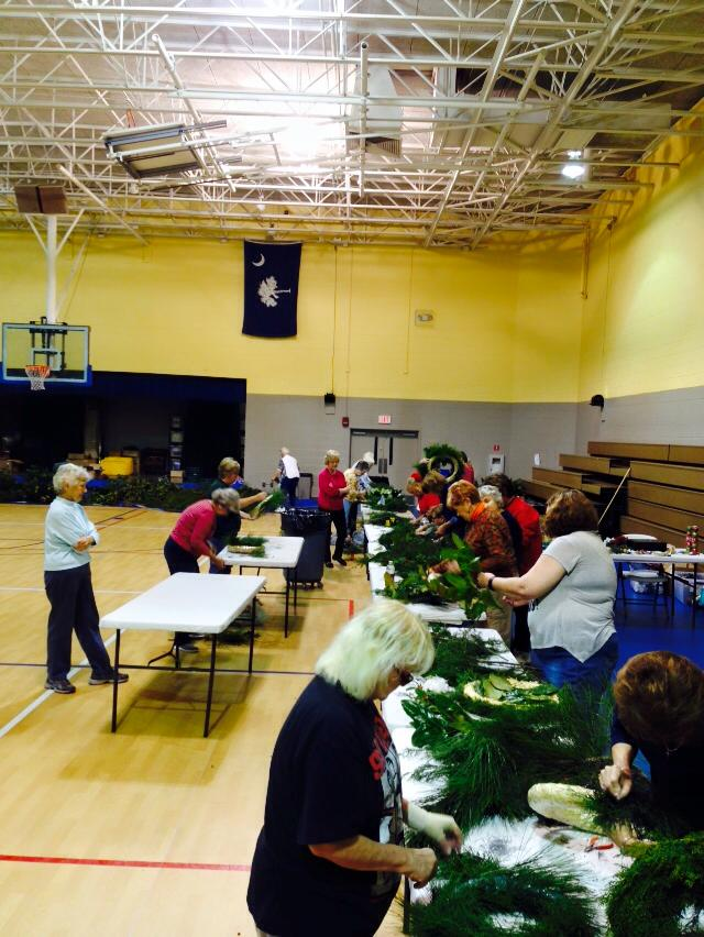 People making wreaths at the Wreath Making Workshop